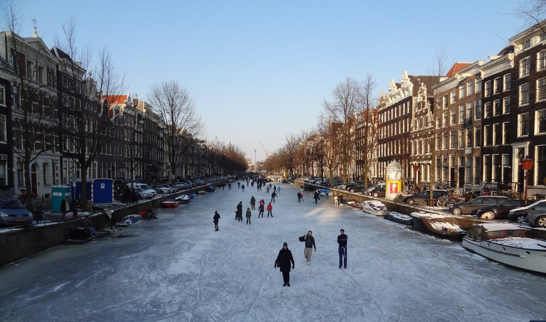 People skating on Amsterdam's frozen canals