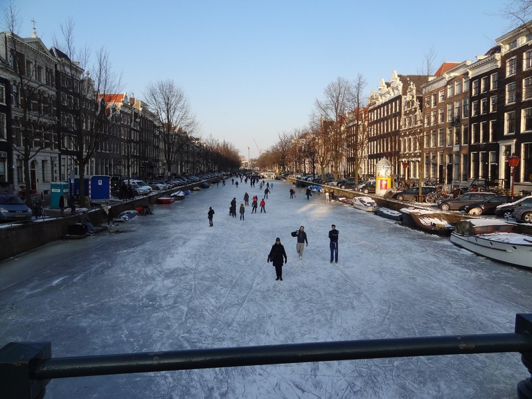 People ice-skating on Amsterdam's canals