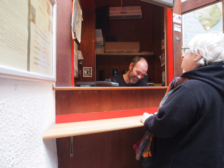 The Actors Studio's Raphaël, handing out tickets from his wooden booth as the first moviegoers of the day start trickling in   © Nana Van de Poel