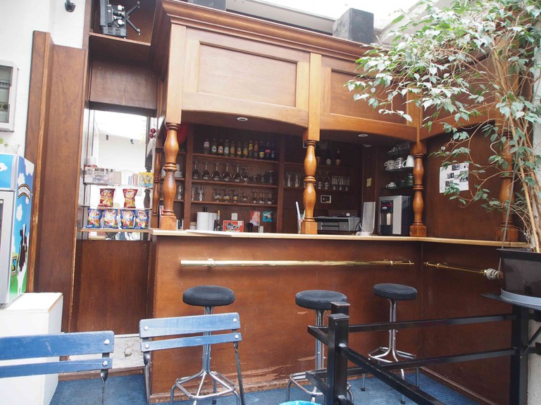 The Studio's old school wooden bar, catalyst for cinephile conversations