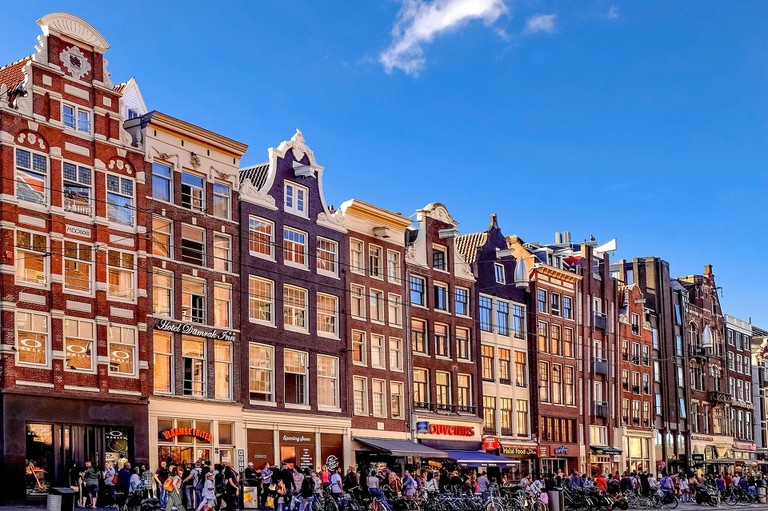 There are dozens of tourist shops on Damrak in Amsterdam