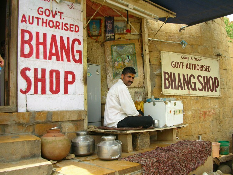 A vendor waits for customers at a traditional Bhang Shop in Jaisalmer, Rajasthan