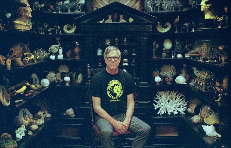 Todd Haynes in front of a cabinet of wonders