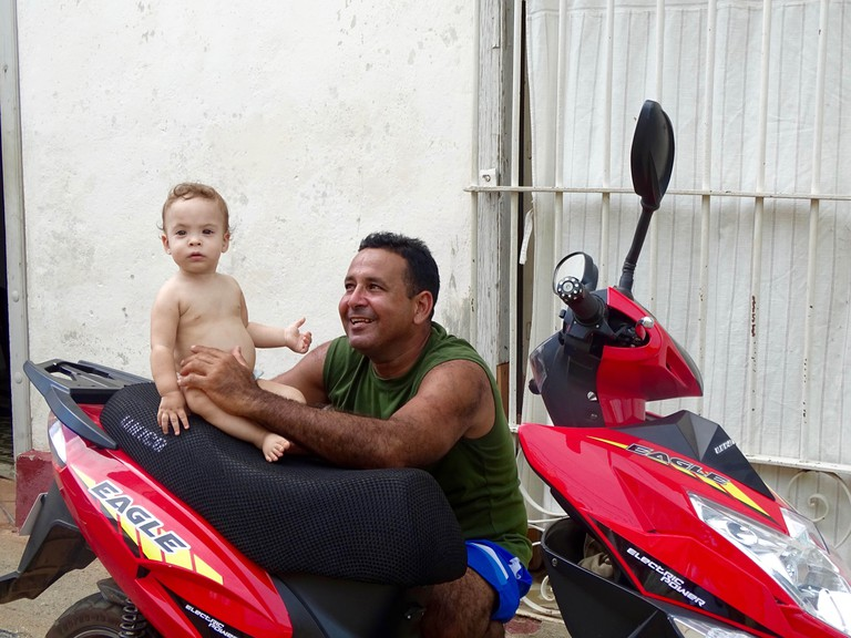 A small child and his father in Trinidad, Cuba