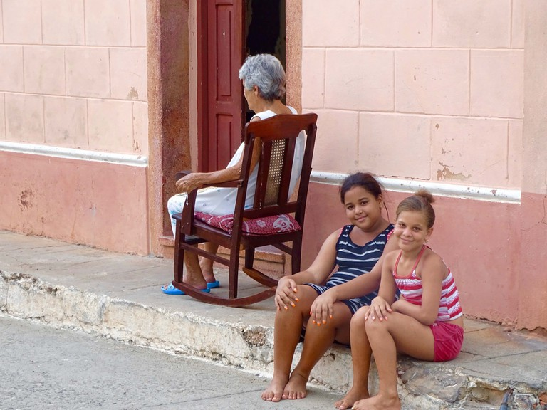 Two girls pose for the camera in Trinidad, Cuba