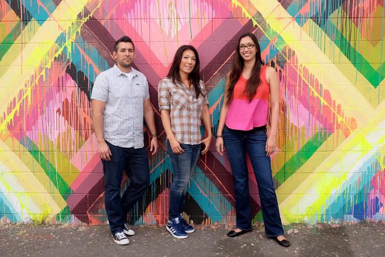 Tina Fitch (center) & Co-Founders Mark Quezada and Tiffany Quezada