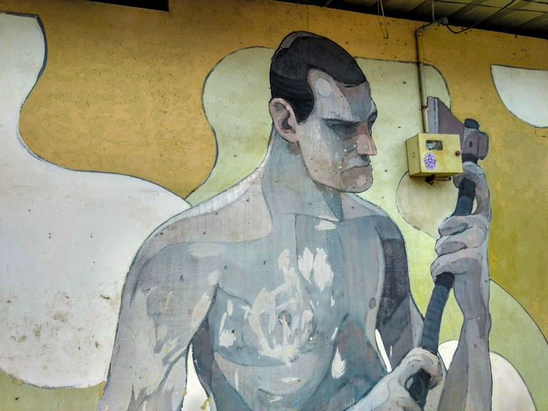Another interesting mural of a laborer at work