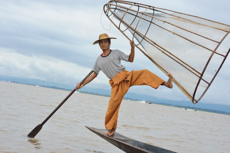 An Intha leg rower shows off at Inle Lake, Myanmar