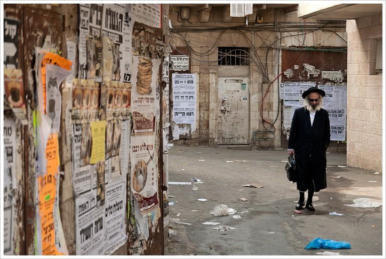 An ultra orthodox Jewish man walks through Mea Shearim, Jerusalem
