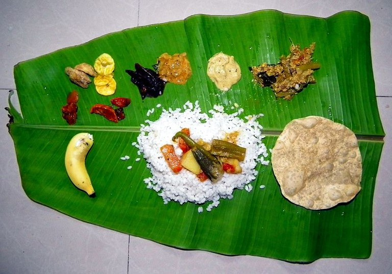 A traditional Onam Sadhya meal served on a banana leaf