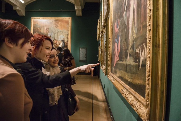 Queen's Gallery Buckingham Palace. Pointing at artworks. Credit Royal Collection Trust Her Majesty Queen Elizabeth II 20