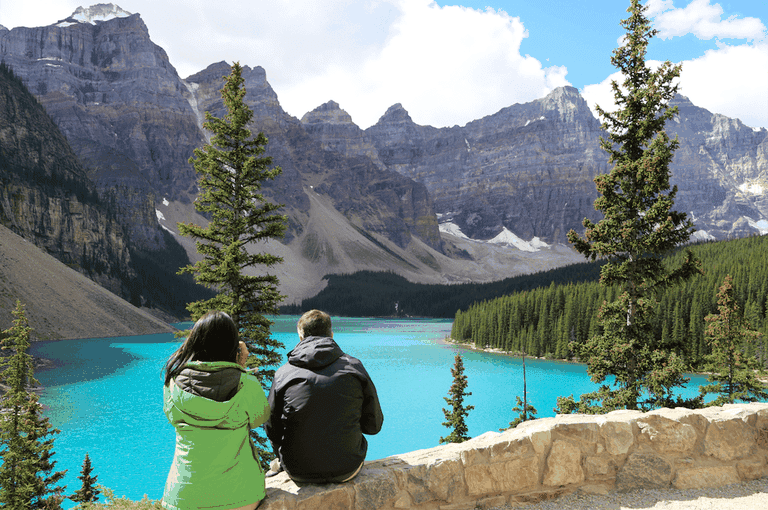 Couple looking at lake landscape