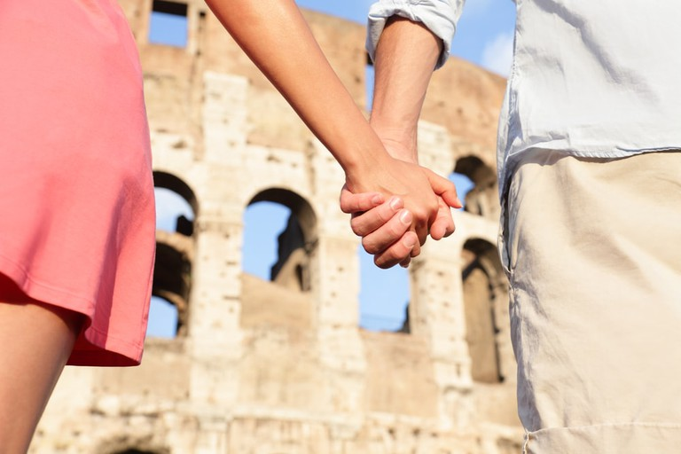 Colosseum couple | © Maridav/Shutterstock