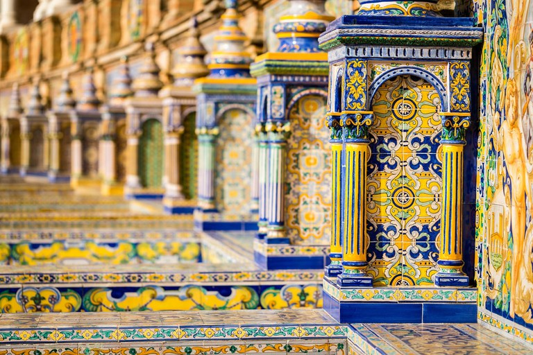 The intricate tile mosaics are one of the Plaza de España's most attractive features