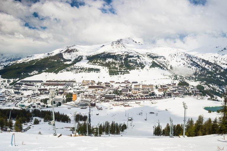 Panoramic view of Sestriere village from above in the Alps, Piedmont, Italy