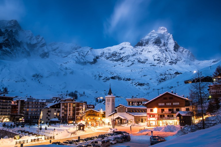 Cervina ski resort and Matterhorn mountain in moonlit blue evening, Valle'd Aosta, Italy