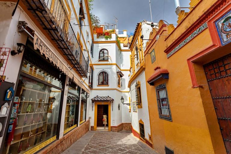 Brightly coloured buildings in Seville's Santa Cruz neighbourhood
