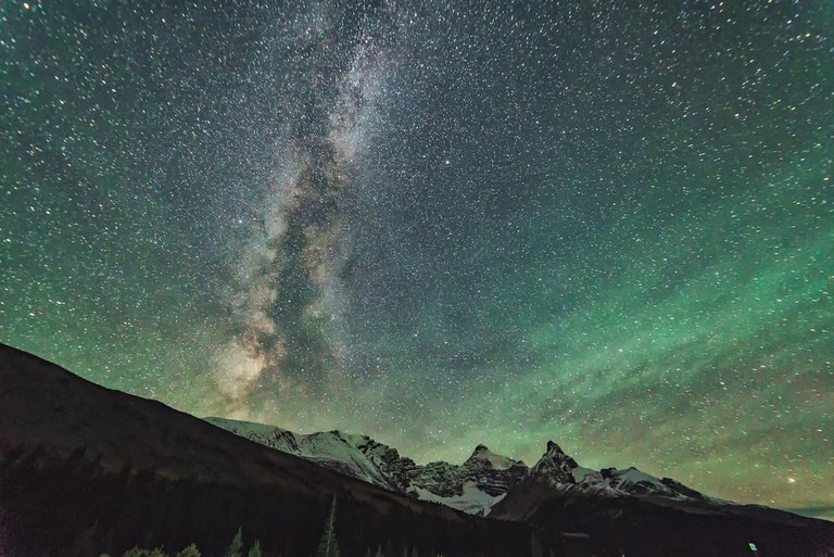 The Milky Way (and Northern Lights) shining over Jasper National Park