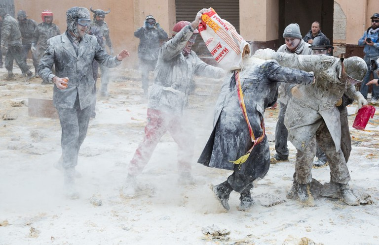 Locals take part in the annual flour fight in Ibi, Spain
