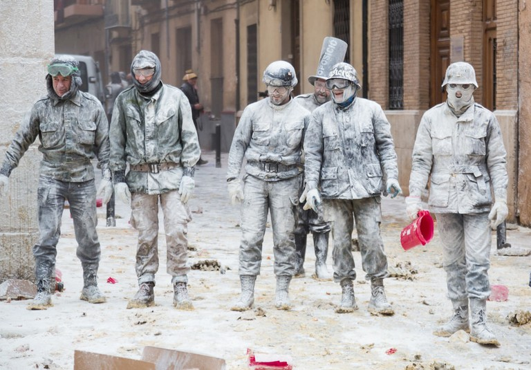 Men taking part in Spain's annual flour festival