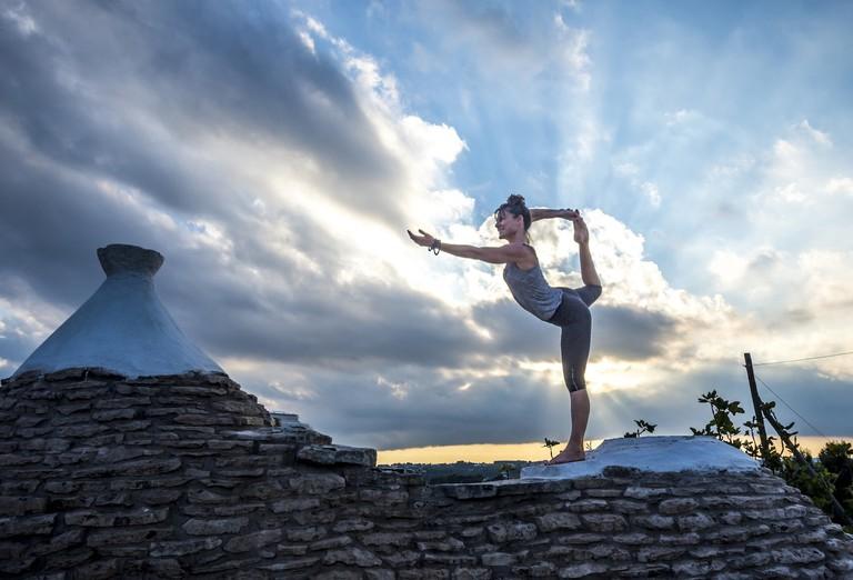 Yoga on the roof of a trullo in Puglia