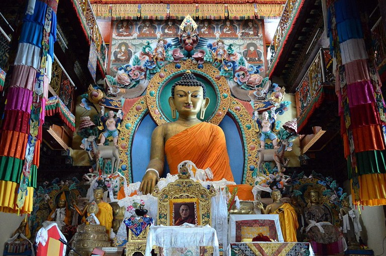 The 18-ft-tall statue of Buddha at the main meditation hall of Tawang Monastery