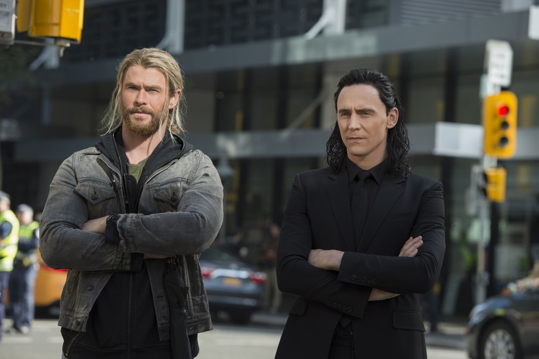 Brothers in (folded) arms. Thor (Chris Hemsworth) and Loki (Tom Hiddleston)
