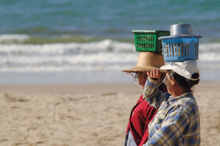 Walking-Vendors-Carry-Fresh-Seafood-Chaung-Tha-Beach
