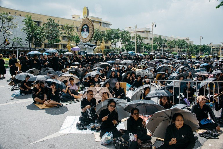 Mourners gather for the Thai king's funeral in spite of the bad weather