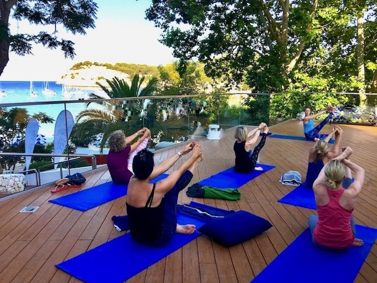 Yoga in Cala Galdana | Courtesy of Yoga Escapes