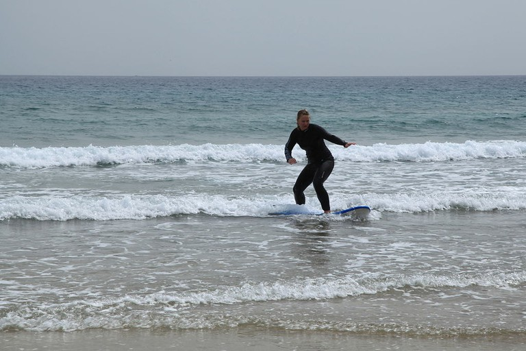 Beginner surfing in Fuertaventura's Playa Blanca
