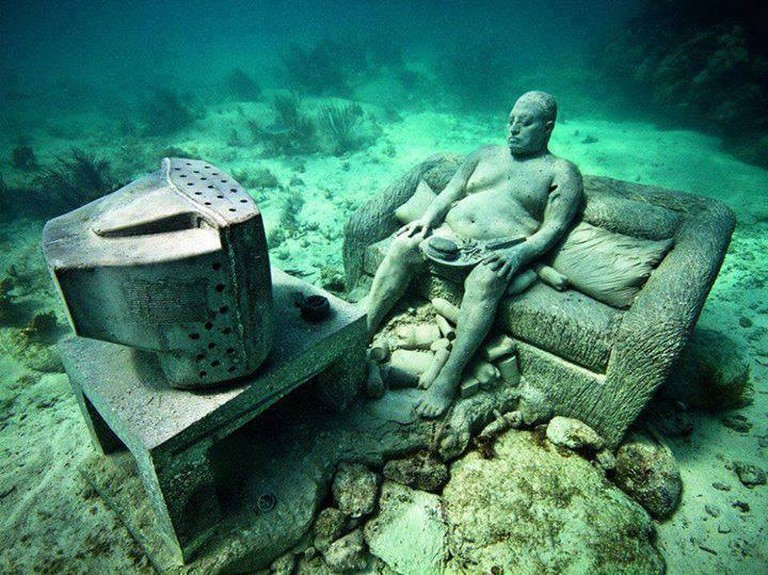 One of the statues at the Cancun Underwater Museum