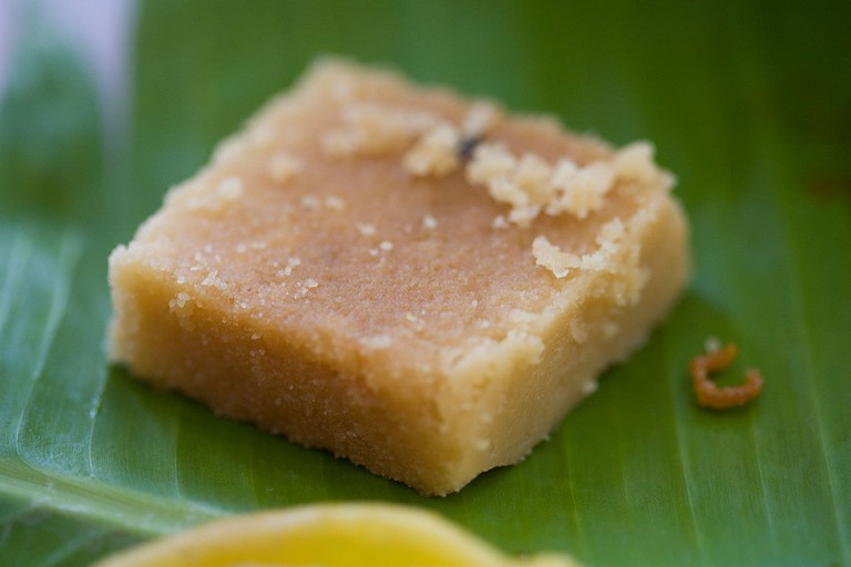 Mysore Pak, a traditional South-Indian sweet served on a banana leaf