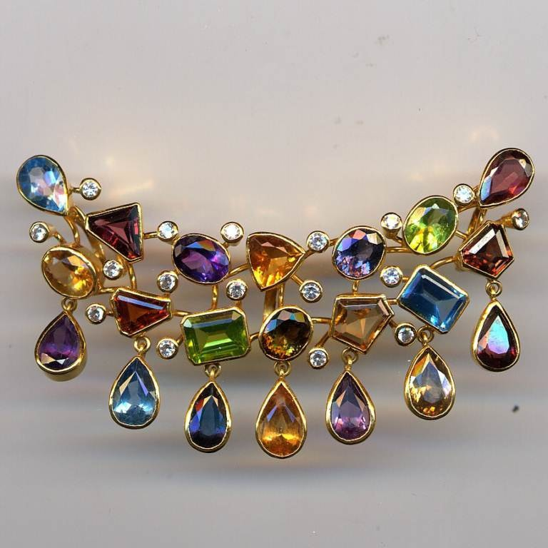 A variety of colored gems on a brooch
