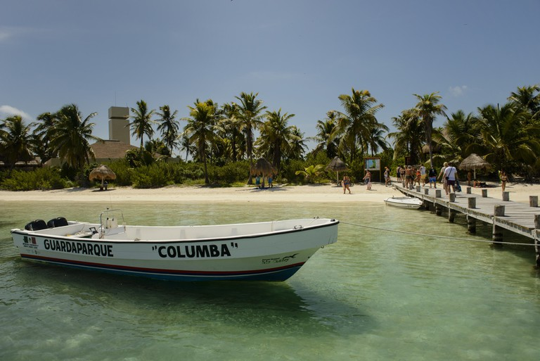 A launch sits by the dock at Isla Contoy, Mexico