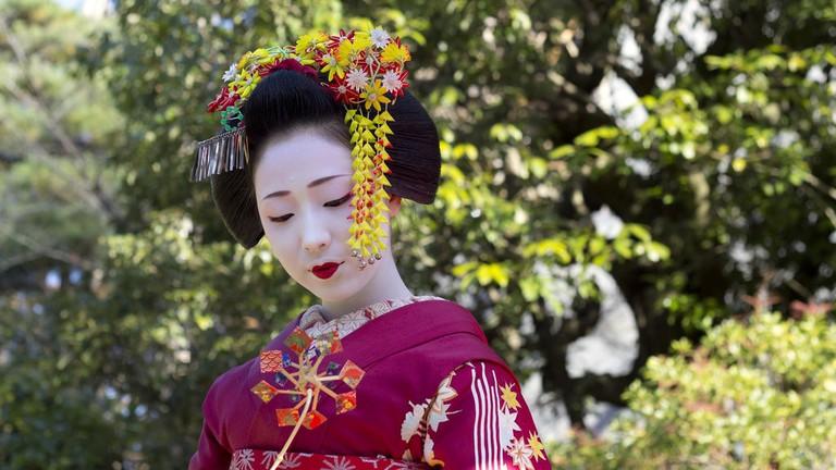 Maiko (or hangyoku) are apprentice geisha/geiko
