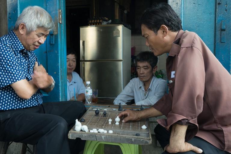 Men playing Thai chess