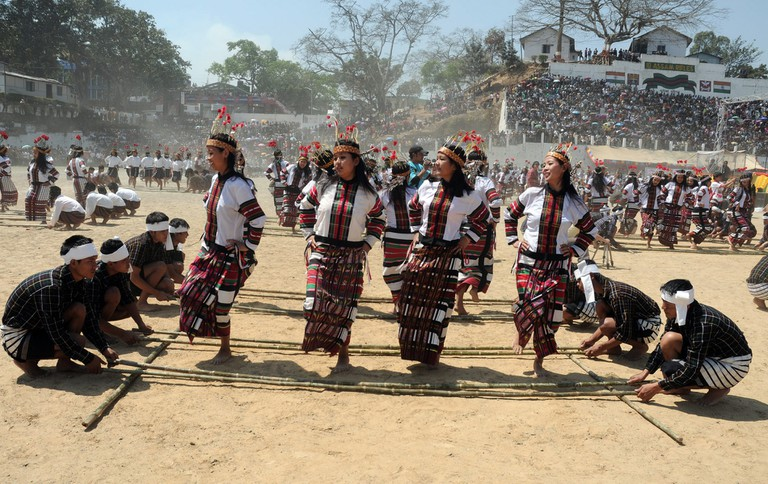 A typical folk dance with bamboo sticks during Chapchar Kut