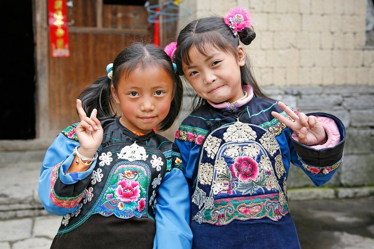 Girls from the Miao ethnic group pose for a picture