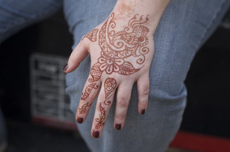 Hand with detailed henna art