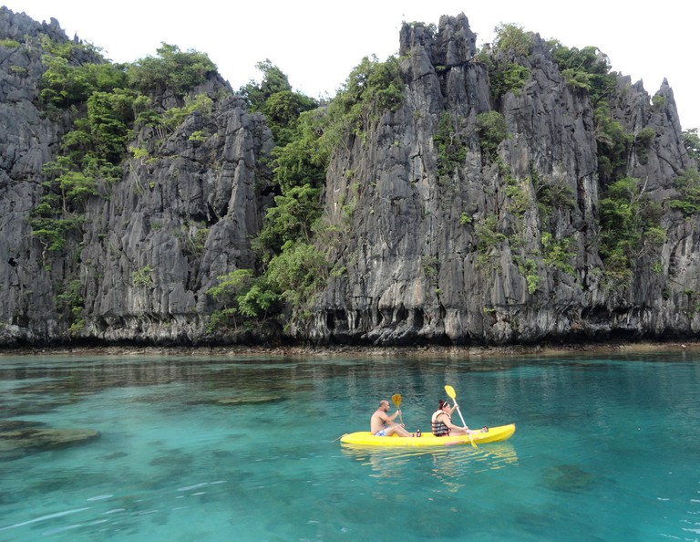 Man and woman kayaking in El Nido's Small Lagoon