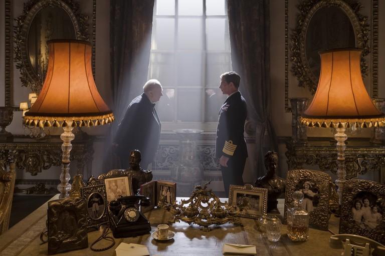 George VI (Ben Mendelsohn, right) invites Churchill (Gary Oldman) to form a government