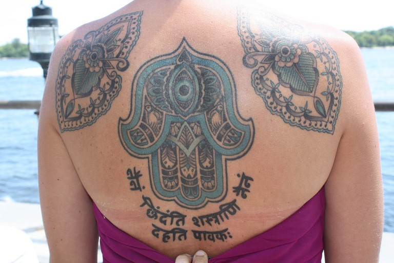 Large tattoo of the traditional Moroccan symbol of hamsa