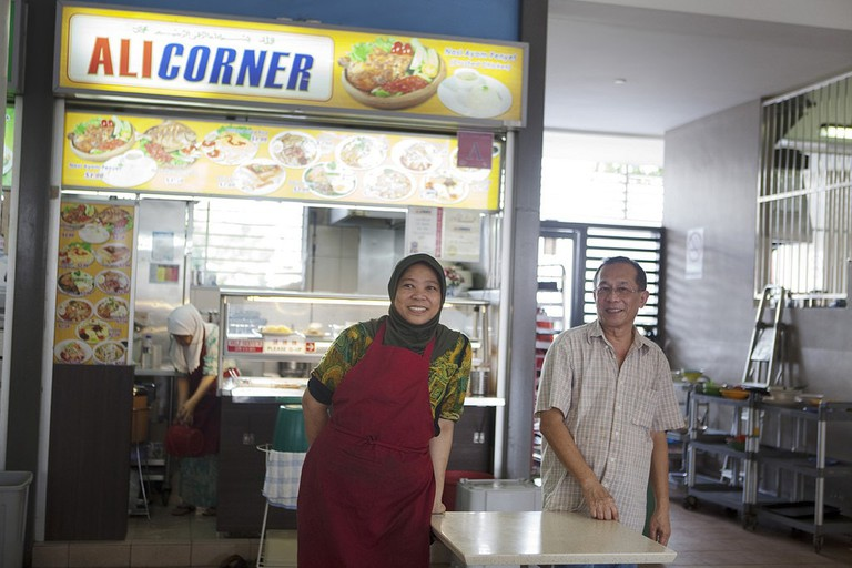 Hawker stall owners in Singapore say hello