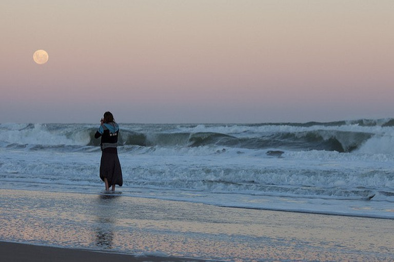 A woman on a Uruguayan beach at twilight