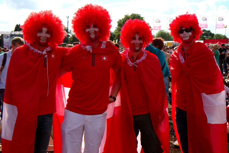 Federer fans draped in Swiss national colours