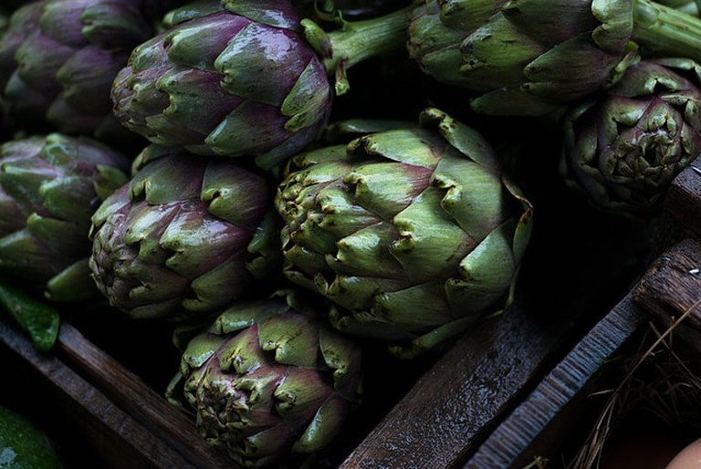 A box full of artichokes