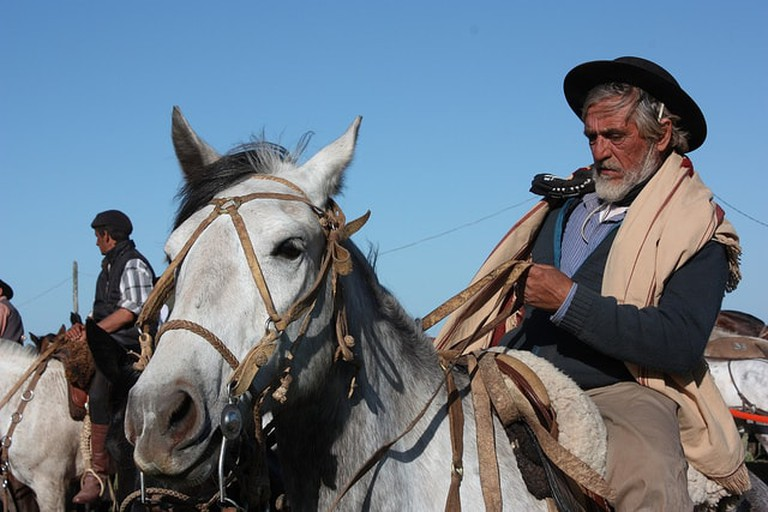 A man dressed as a gaucho on horseback