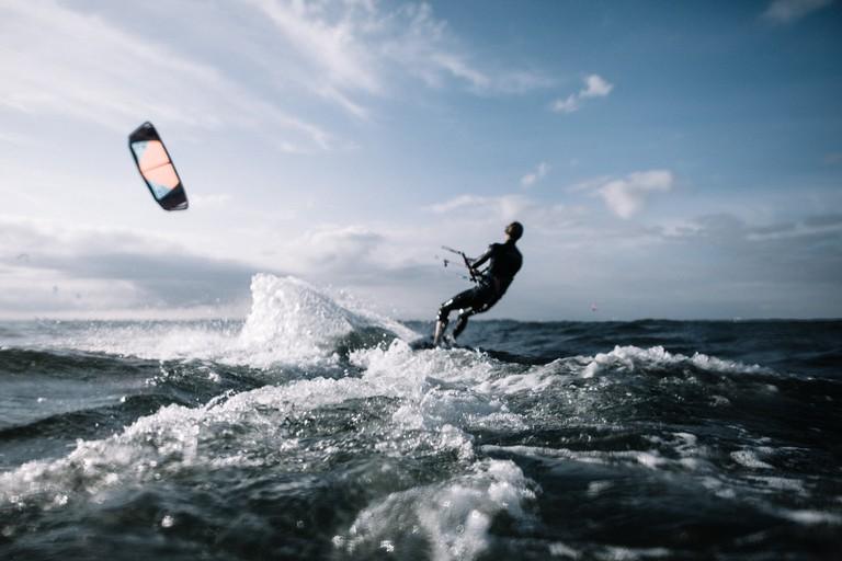 A man kite surfing