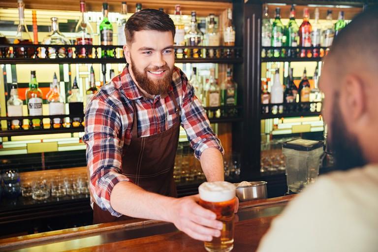 Barman serving pint | © Dean Drobot/Shutterstock